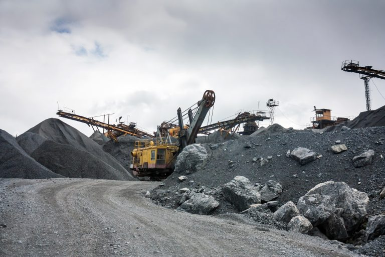 Image of a quarry showing screening and crushing machinery